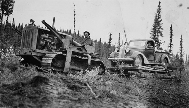 "A Caterpillar ""Diesel Forty"" pulling a Dodge truck on skids to Coal Creek mining camp, ca. 1936.  University of Alaska Fairbanks, Stanton Patty Family Papers (2012-93-80)"