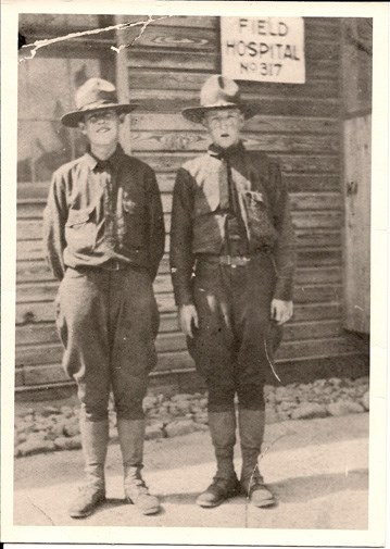 Black and white photo shows two young men in uniform outside field hospital at Camp Lee, Virginia
