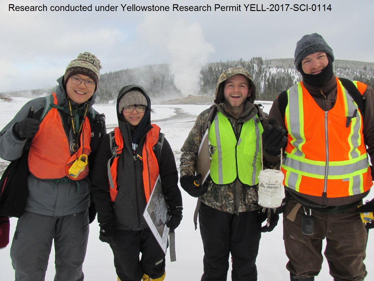 Geologists from University of Utah conduct research on Old Faithful geyser. (Left to Right:  Max Jin Hansheng, Sin-Mei Wu, Jonathan Voyles, Jamie Farrell)