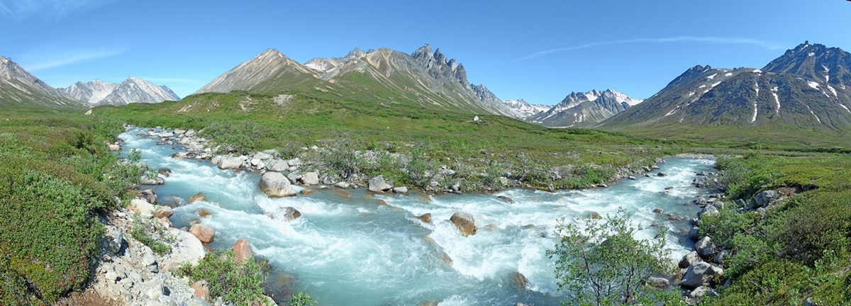 A panorama of a river with many rocks