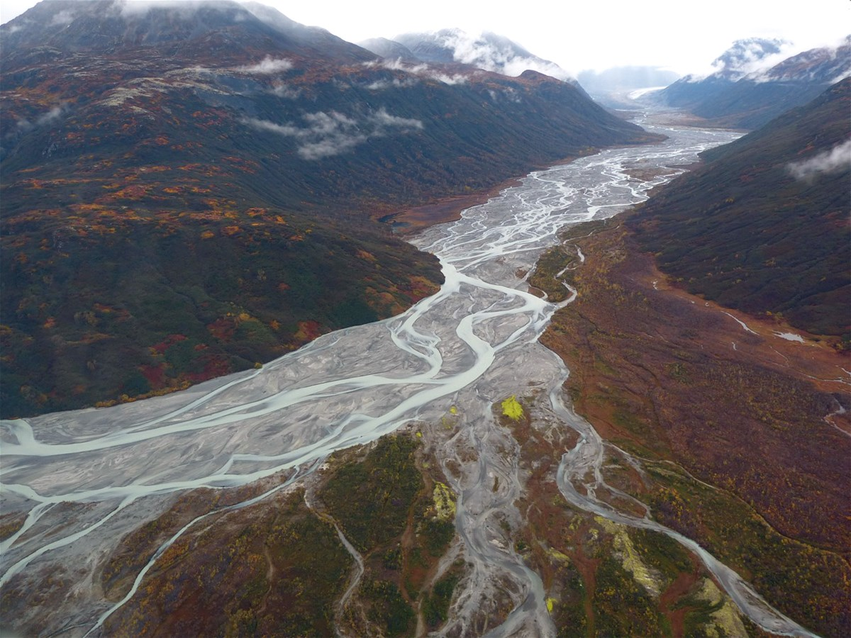 An aerial view of a braided river valley in autumn