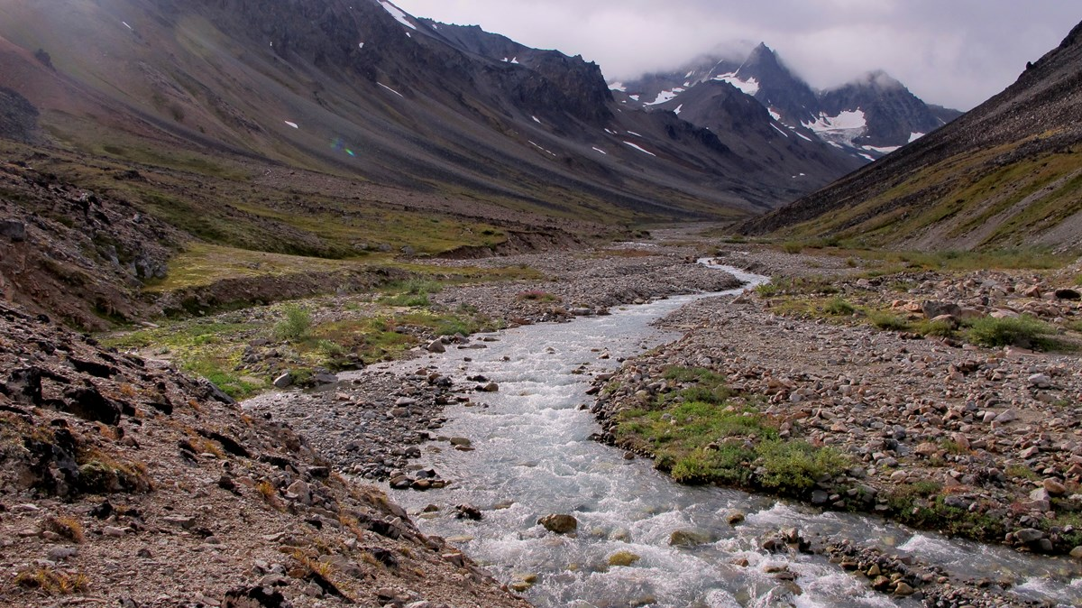 A river winds through a rocky valley