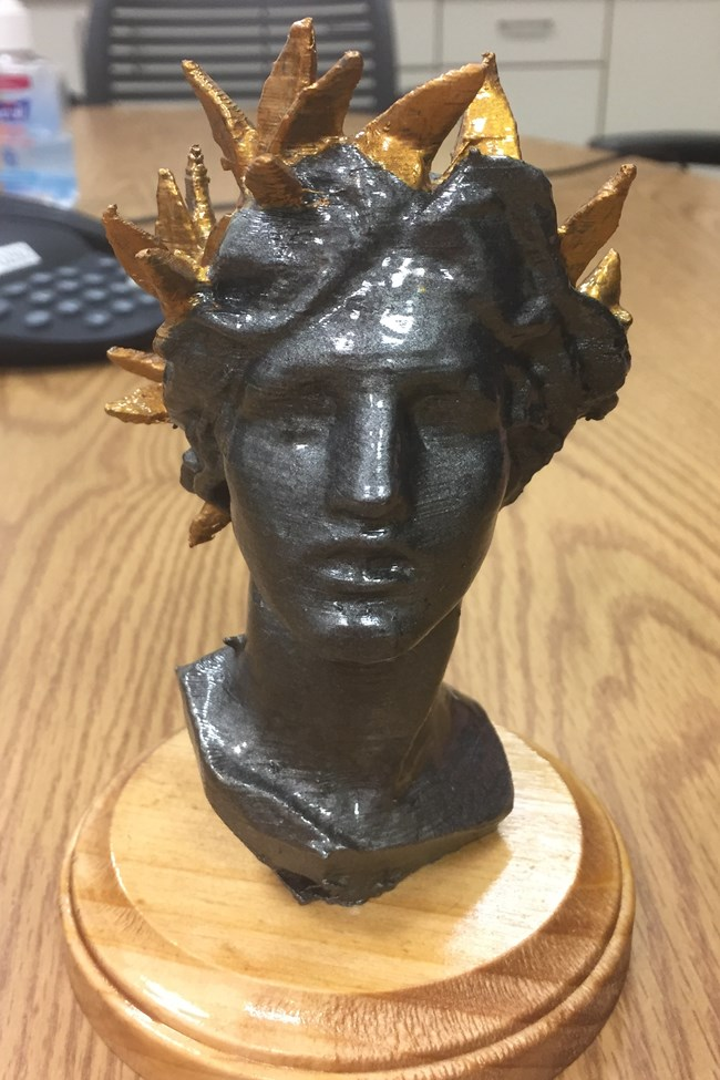 Small bust of a woman's face made on a 3D printer.