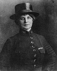 Woman in black military service uniform.