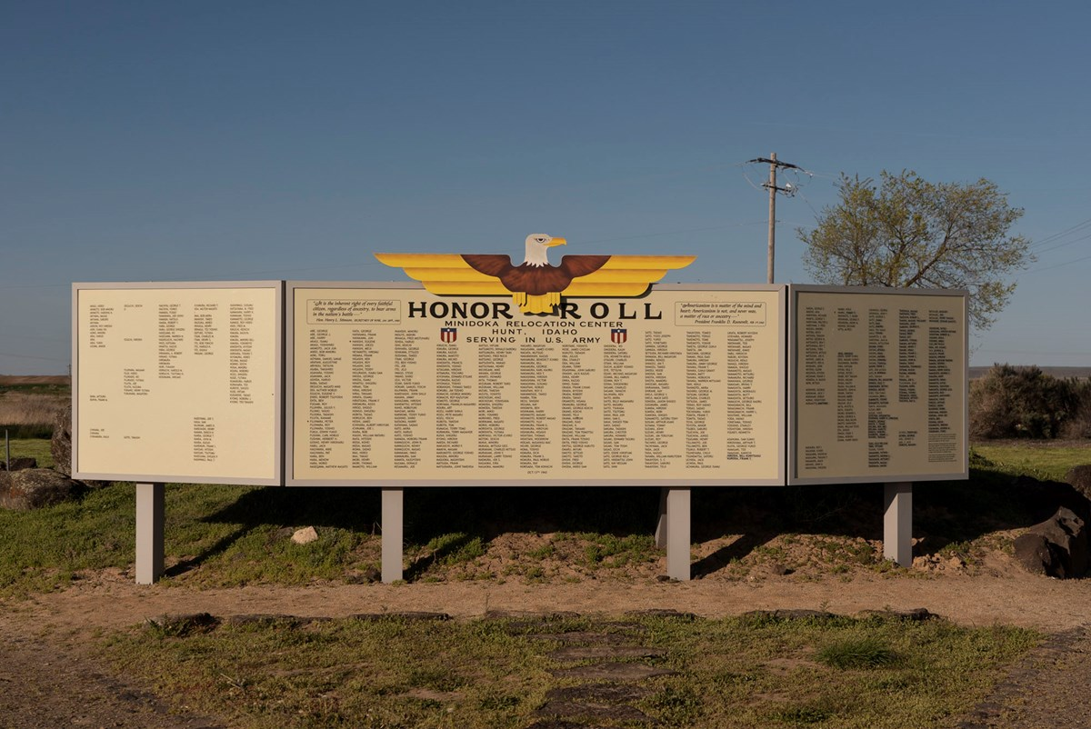 "Outdoor exhibit panels titled ""Honor Roll"" listing names of Minidoka incarcerees who served in the US Army"