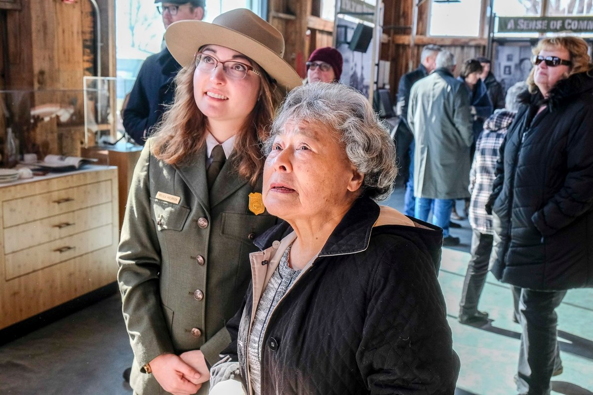 Ranger and her grandmother in a visitor center