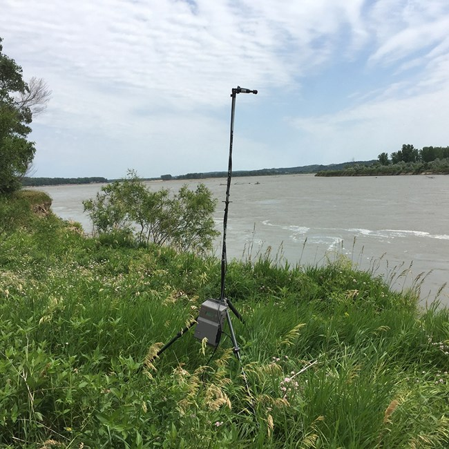 Bat acoustic monitoring equipment set up on the bank of the Missouri River