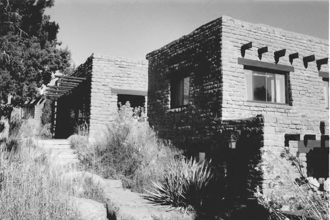 two adobe buildings