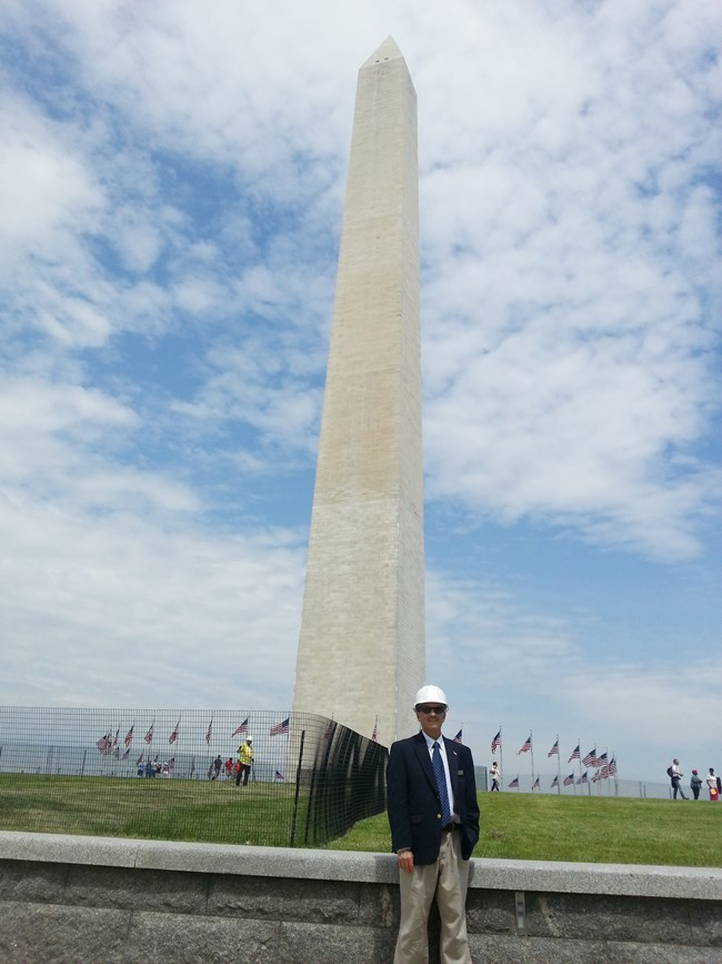 Mike Morelli standing in front of the Washington Monument