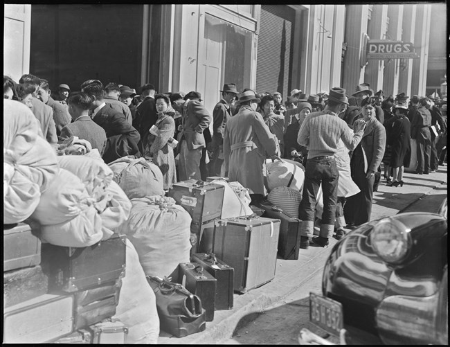 Japanese Americans awaiting to be placed in concentration camps.