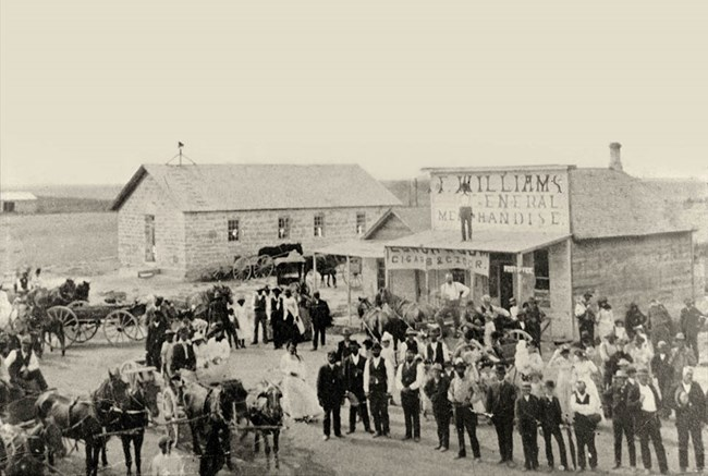 Men and woman gather on Washington Street in 1855