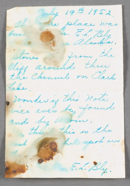 Image of a note, handwritten in blue ink.