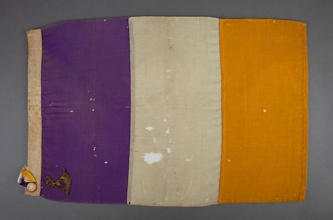 Purple white and gold flag of the NWP. National Museum of American History