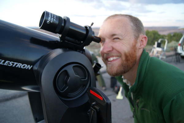 Dark Sky Defender Nate Ament views the stars through a telescope