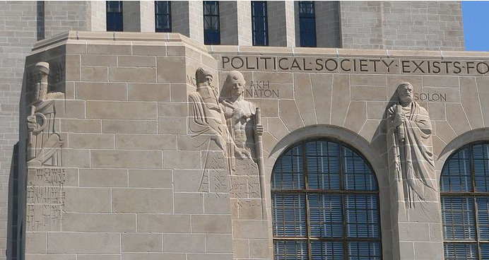 Stone sculpted figures in the side of the Nebraska State Capitol building.