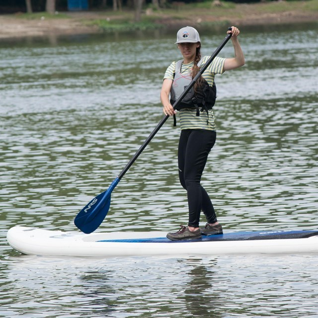 Woman wearing a life jacket on paddle board