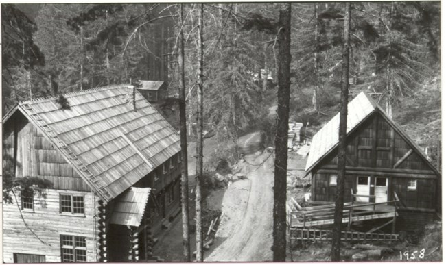 Black and white image of wooden buildings belonging to the Ohanapecosh Hot Springs Resort.