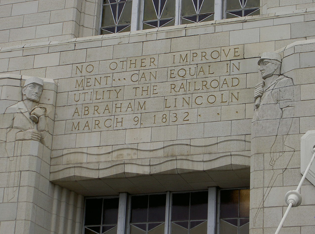 Stone carvings of words and two men into the side of Omaha Union Station.