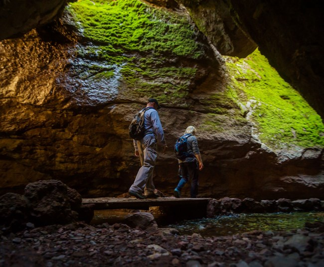 hikers in talus cave