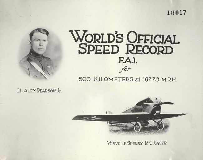 "Document with photo of Alexander Pearson and Verville Sperry R-3 Racer aircraft. Text reads ""World's Official Speed Record F.A.I. for 500 Kilometers at 167.73 M.P.H."""