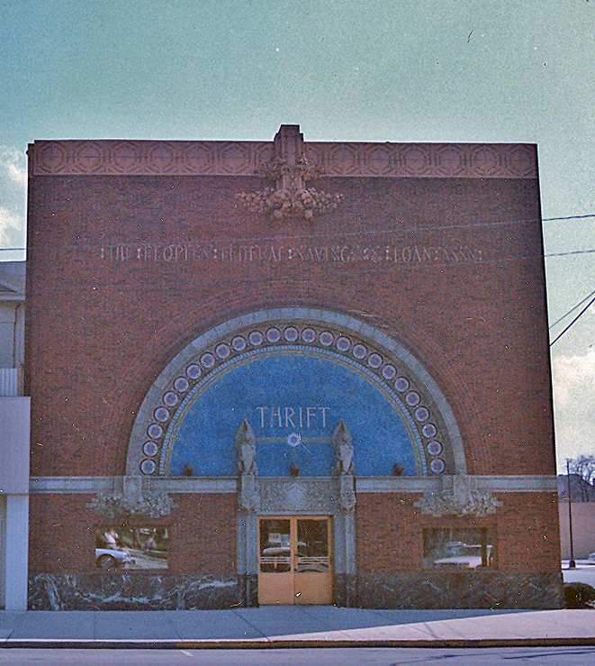 Brick building with a large, arched window.