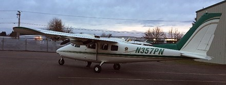 A small plane with a green stripe.