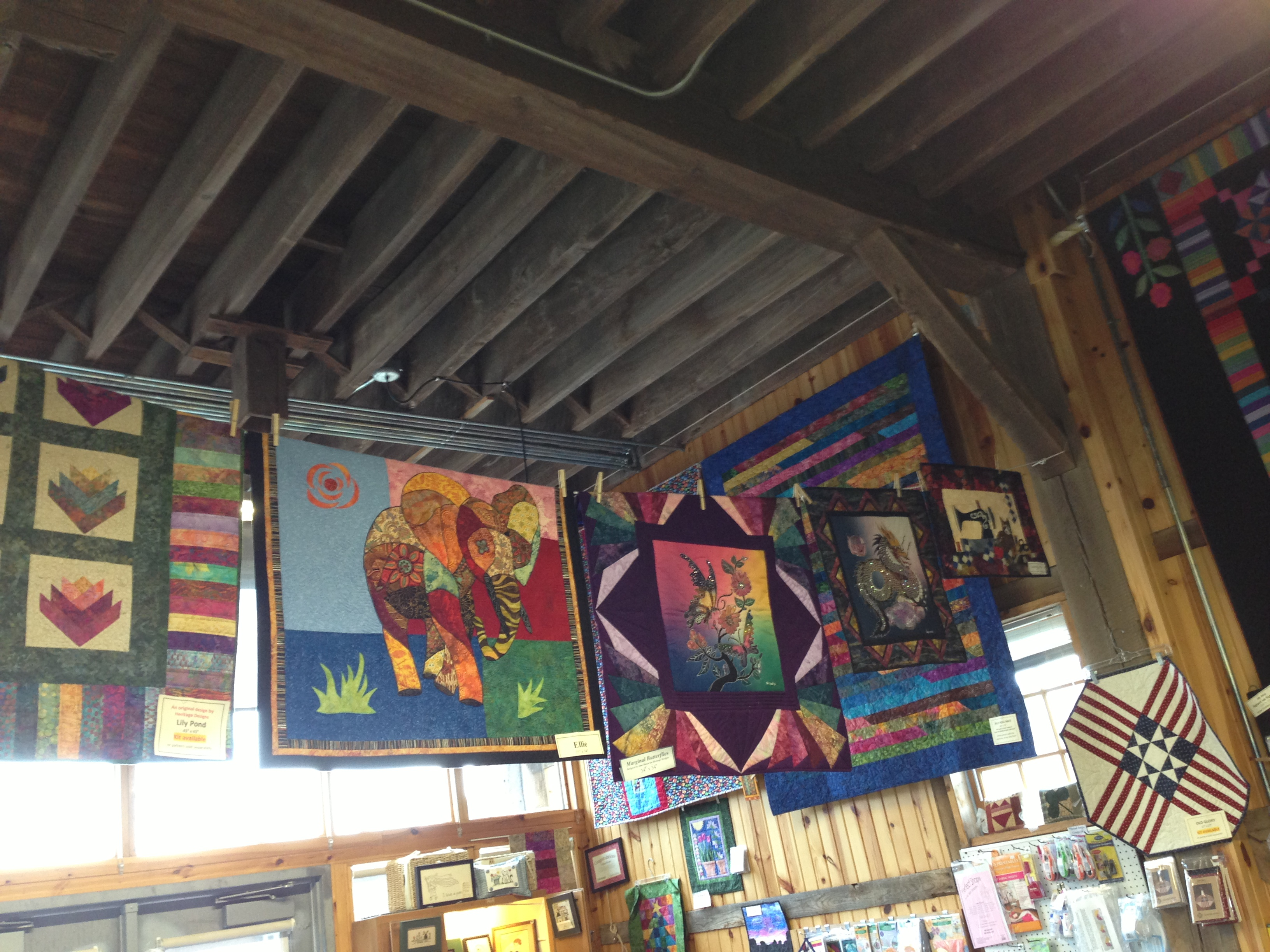 Multi-colored hanging on the walls and from the wooden rafters.