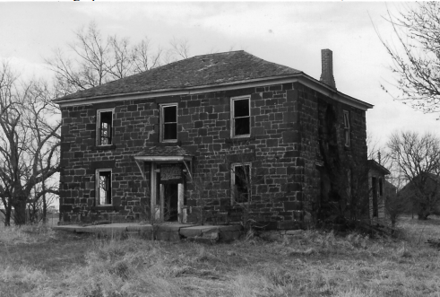 B&W photo of a two-story brick house.