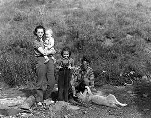This 1940 photograph shows Adolph Murie, his wife Louise, son Jan, and daughter Gail in Mt. McKinley National Park.