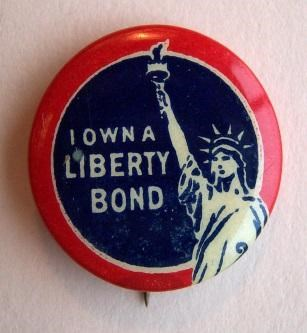 Small red and blue pin with image of statue of liberty