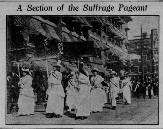 Newspaper photo of women marching in suffrage procession