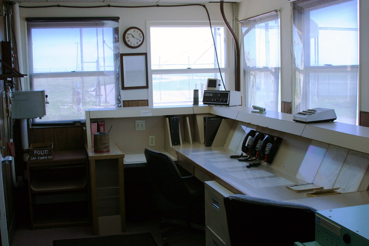 Office with a large console desk and many windows