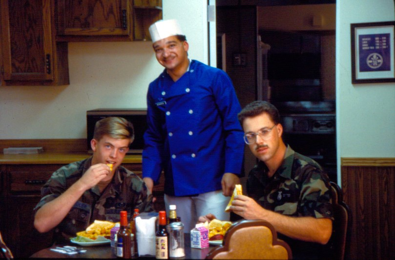 A military chef with two uniformed airmen