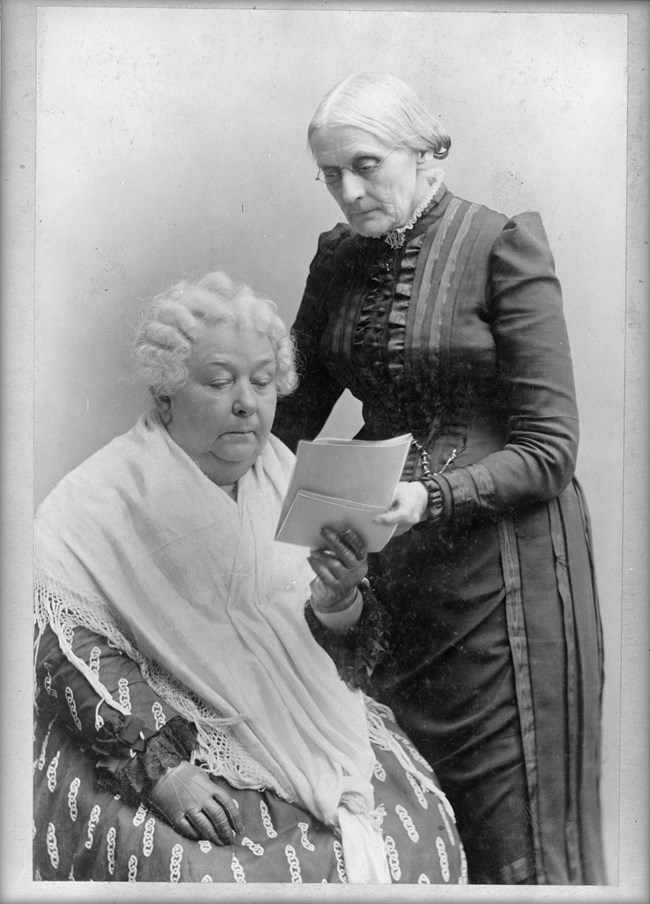 Susan B Anthony and Elizabeth Cady Stanton reviewing document