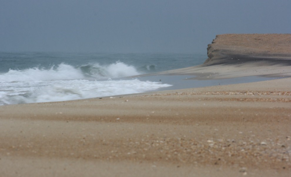 beach and low bluff, storm waves breaking