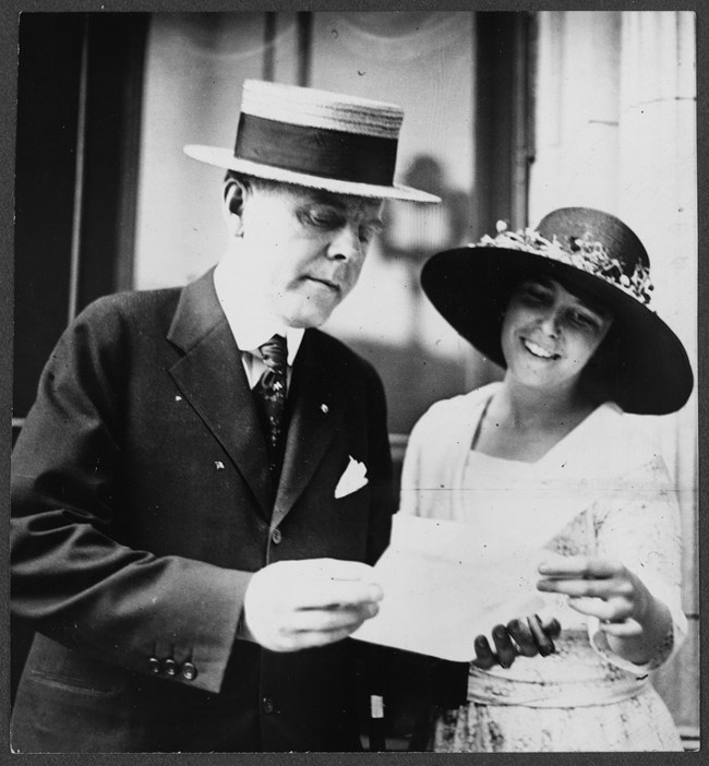W.J. Jameson, head of the National Finance Committee of the Democratic Party and suffragist Anita Pollitzer of the National Woman's Party check the latest tally of vote pledges in favor of the 19th Amendment. Library of Congress.