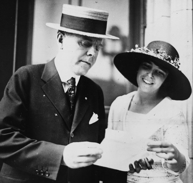 W.J. Jameson, head of the National Finance Committee of the Democratic Party and suffragist Anita Pollitzer of the National Woman's Party check the latest tally of vote pledges in favor of the 19th Amendment. Library of Congress, Records of the National W