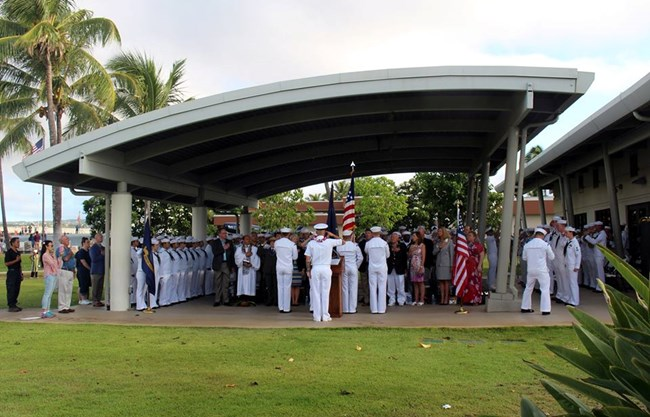 Group stands in ceremony to celebrate US Navy birthday.