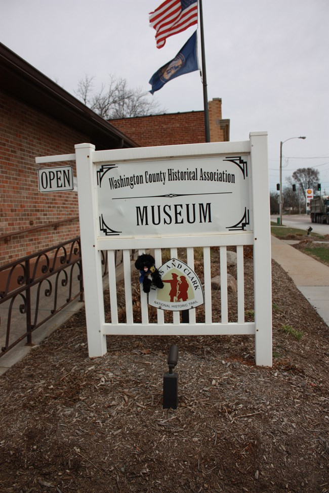 Pup on museum sign