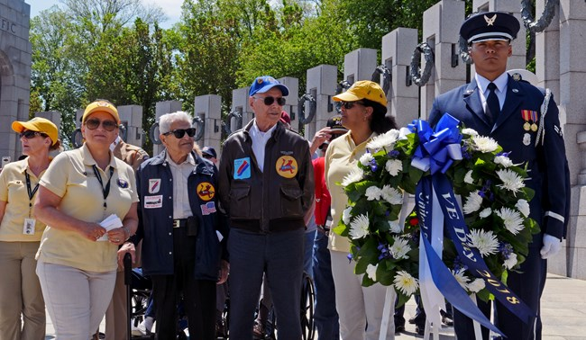 A group prepares to lay a wreath at the World War II Memorial