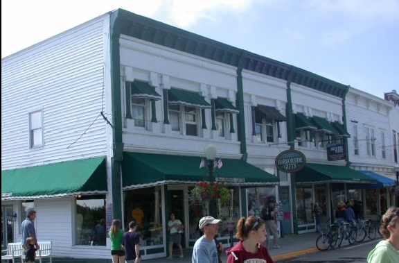 White building with green awnings.