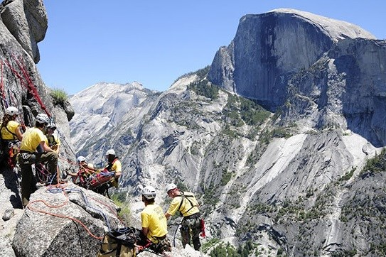 Hiker being rescued by Yosemite Search and Rescue after becoming stranded on a cliff ledge