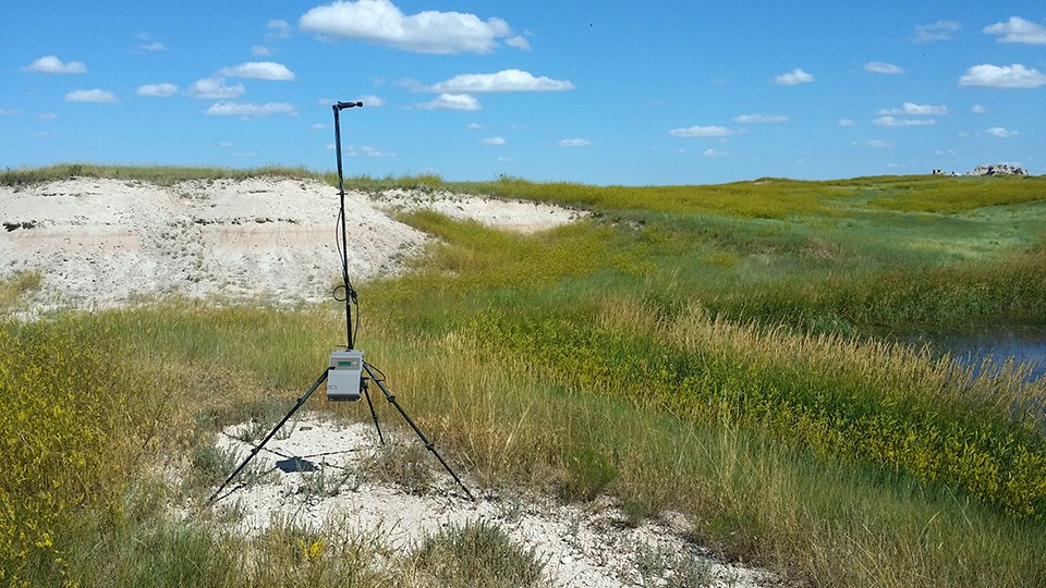 An acoustic monitoring station set up by a stock pond