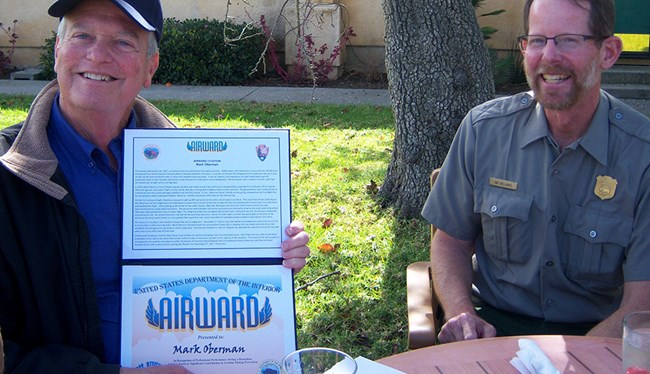 Mark Oberman (left) holds Airward, while Channel Islands ranger, Ian Williams sits to the right.