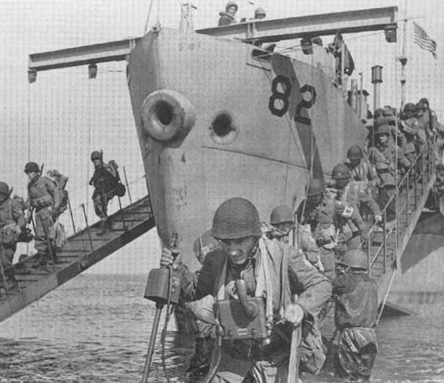 soldiers disembarking from boats into shallow water