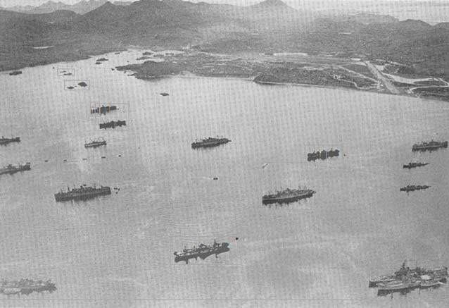 aerial view of world war two era ships in a harbor