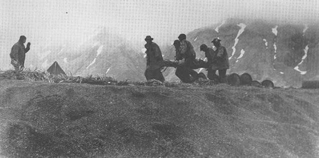 soldiers carrying a litter on a hill