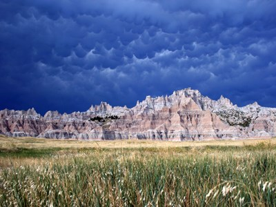 A scenic view of Badlands National Park, its unique land forms in the distance