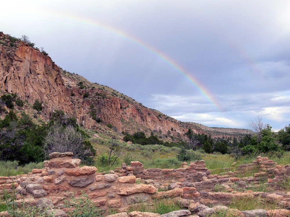 Rock formations, ruins, and rainbow