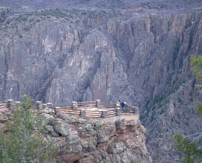 Park visitors looking at Black Canyon from Gunnison Point
